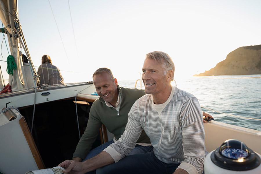 men sitting on boat
