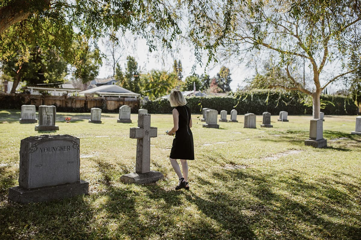 woman at cemetary