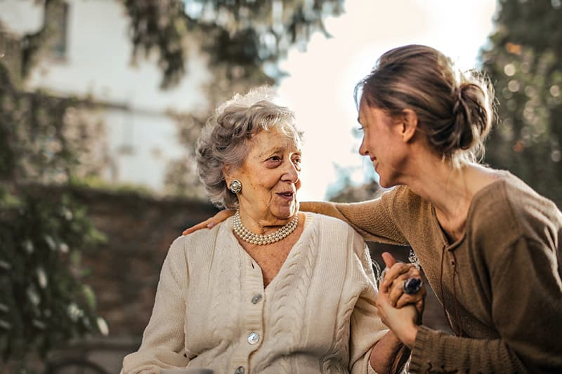 elderly woman talking to granddaughter